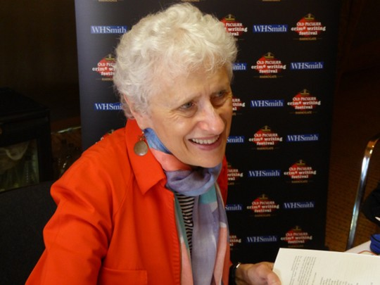 Legendary Sara Paretsky signs books for fans.
