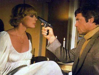 Oliver Reed points the pistol of guilt at Elke Sommer in the 1974 film adaptation.
